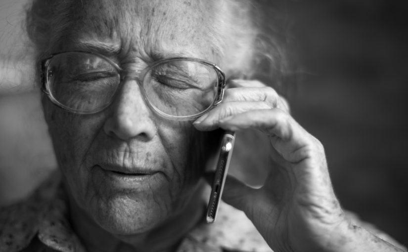 Older person listening on the telephone